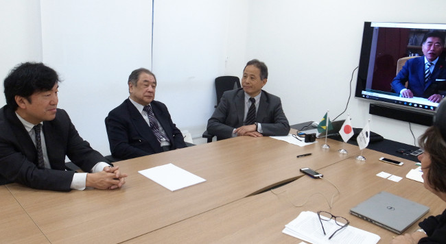 Interview by the JHSP press representative <br/> (with a video message by President Tsuchiya in the background)