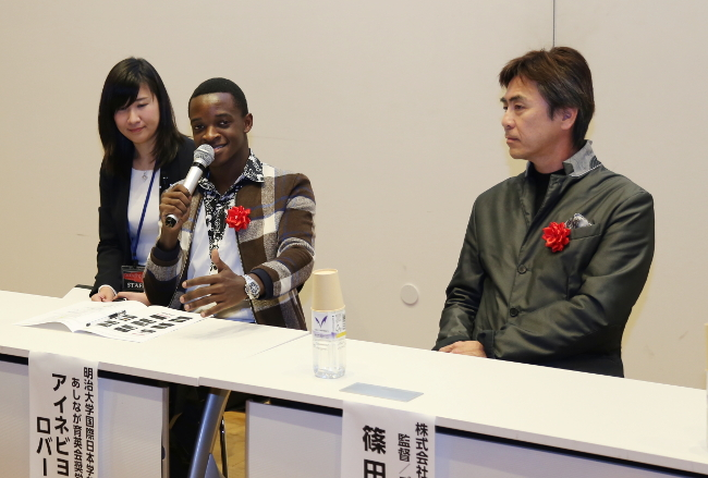 "(Left) Mr. Robert Ainebyoona, a Ugandan who is a third-year student at the Meiji University<br/> (Right) Shinji Shinoda, the film director of ""Daddy Long Legs"""