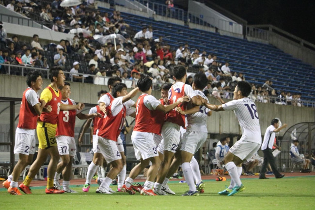 The team celebrates after making the winning goal (Photo: Athletic Association's Soccer Club)