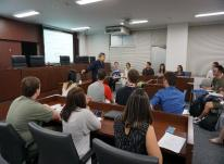 A lecture on the judicial system by Associate Professor Teruhisa Komuro of the School of Law, held in a mock courtroom